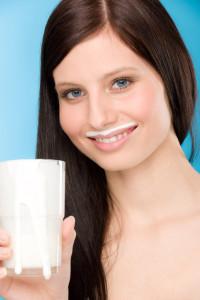 Healthy lifestyle - woman drink milk breakfast