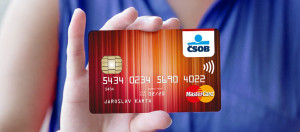 Woman holding blank credit card in hand