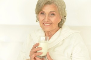 Seniour woman drinks milk
