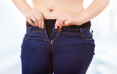 Size,40/42,Woman,Zipping,Tight,Jeans,,Obesity,And,Overweight,Concept